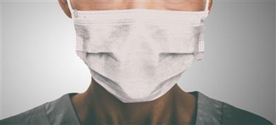 surgical face mask being worn